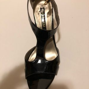 Black patent leather Nine West sandal. Like new.